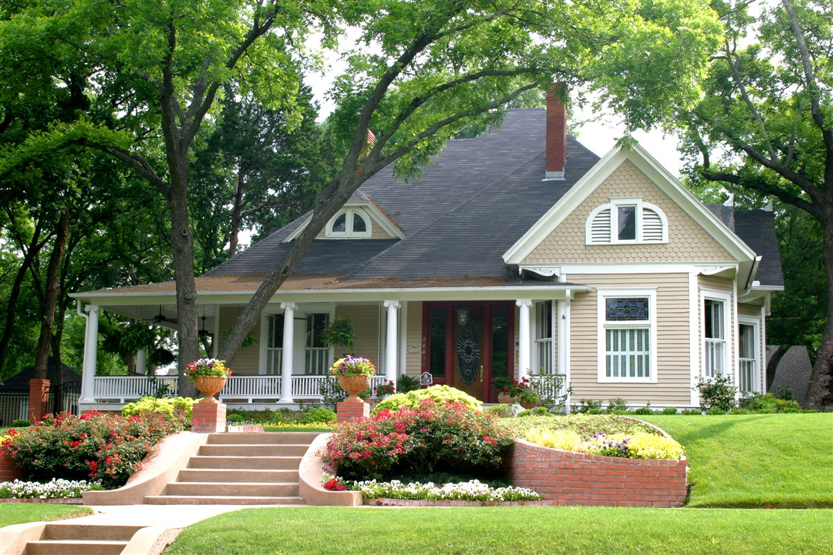 CONSIDER THE TREES ON YOUR LOT WHEN YOU PICK A SPOT FOR YOUR HOUSE